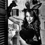 Woman with bunny ears and big heart, Rome, 2016