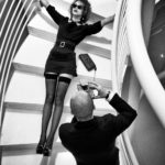 A man taking a photo of a woman on the stairs, Argentario, 2014